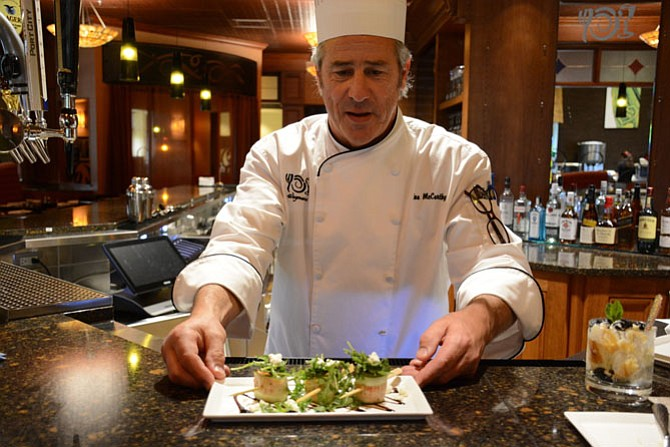 Joe McCarthy of Fairfax Station, executive chef of The Pub at Wegmans in Alexandria, serves up Cucumber Roulades: ribbons of cucumber rolled with roasted tomato and feta cheese.