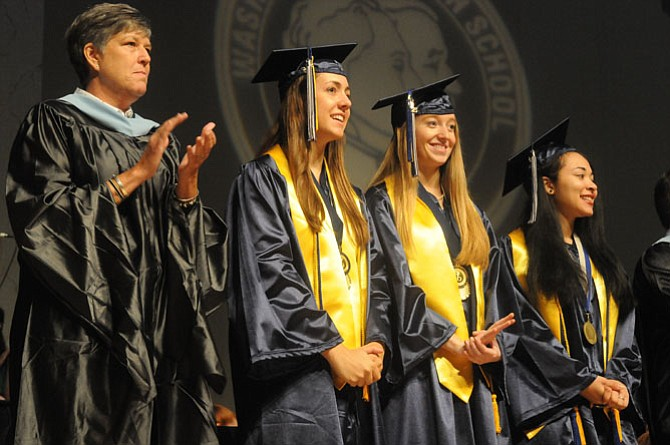 Valedictorian Brandi Moore, senior class president Mackenzie Sturka, senior class vice president Maria Serfis and director of student activities Carol Calloway at Washington-Lee High School's graduation in D.A.R. Constitution Hall on June 18.