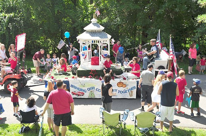 The Celebrate Great Falls float makes its way down Columbine Street during the annual Great Falls Fourth of July parade.
