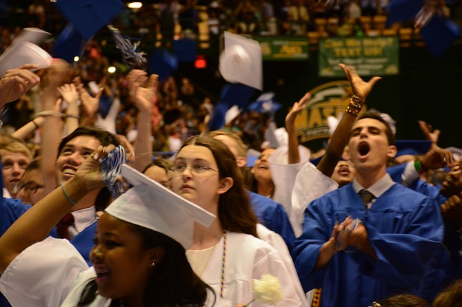 West Potomac seniors celebrate after being proclaimed graduates in the June 18 ceremony.