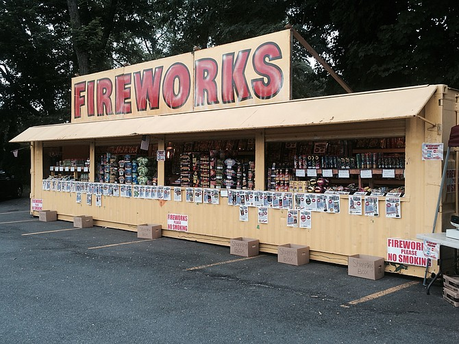 Fireworks are sold at a local stand at Lee Highway and N. Harrison Street in Arlington. Fireworks are synonymous with July 4th celebrations, but creating a fireworks display at home is illegal in some local jurisdictions.