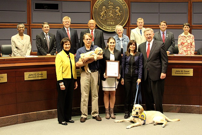 The Fairfax County Board of Supervisors recognized Jacqueline Cheshire for her years of dedication as a volunteer to Canine Companions for Independence. Cheshire was awarded the Governor's Volunteerism and Community Service Award for her work.