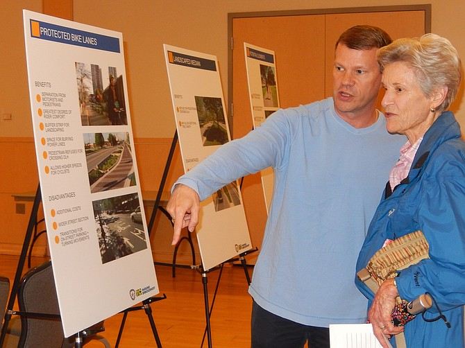 City Councilman Jeff Greenfield and resident Diane Henn discuss bike lanes in the project area.