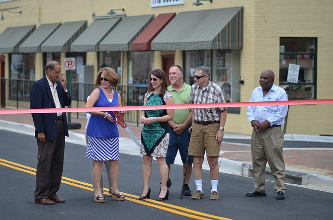 On June 16 residents of Herndon celebrated the reopening of the new and improved Station Street. Mayor Lisa Merkel, economic development manager Dennis H. Holste, Jr., former mayor Michael O'Reilly, Melissa Jonas and town councilmember Jasbinder Singh were some of the local officials who attended the ribbon cutting ceremony.
