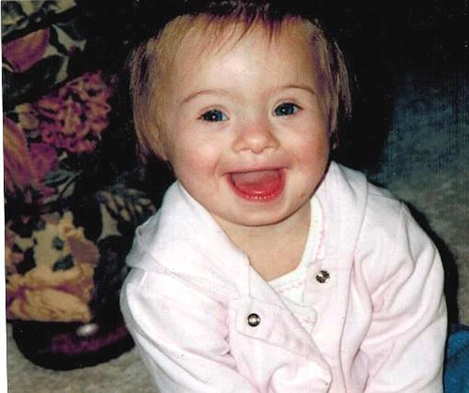 Faith Boone at 18 months, smiling her angelic smile during the Christmas season in 2003.