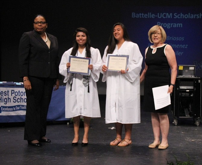 UCM Executive Director Nichelle A. Mitchem (far left) and Meg Silva (far right) of Battelle present Battelle-UCM Scholarship awards at West Potomac High School to Jennifer Jimenez (left) and Dana Briosos (right).