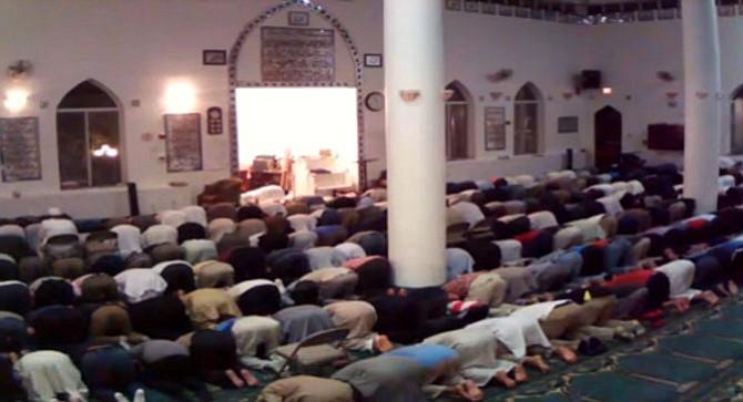 Men at the Islamic Center Northern Virginia Trust bow during the evening's last prayer Isha'.