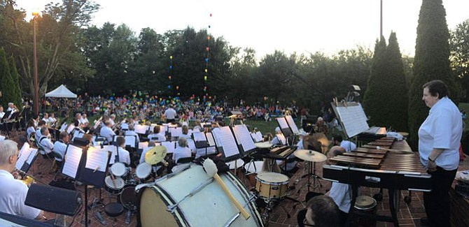 The City of Fairfax Band welcomes children to try out instruments then performs a concert during their annual children's night.