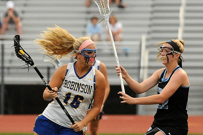 Centreville graduate Caroline Wakefield, right, will play lacrosse at the University of North Carolina.
