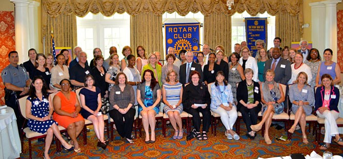 Representatives of 45 local nonprofits gather for a group photo after being presented grants totaling more than $112,000 from the Rotary Club of Alexandria June 30 at Belle Haven Country Club.