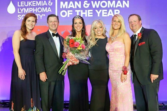 "Here, Katie Simmons Hickey is crowned ""Woman of the Year."" The 22 candidates for Man and Woman of the Year raised $1.81 million, a new record for the National Capital Area Chapter"