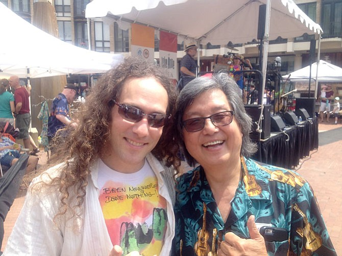 Musician Stuart Fuchs with Oak Hill resident and musician Glen Hirabayashi of the Aloha Boys. Both played at the Saturday, July 11 annual Ukulele Festival in Reston.The festival was hosted by the Lake Anne Merchants with support from the Reston Community Center, Friends of Lake Anne (FOLA), and the Northern Virginia Ukulele Ensemble.