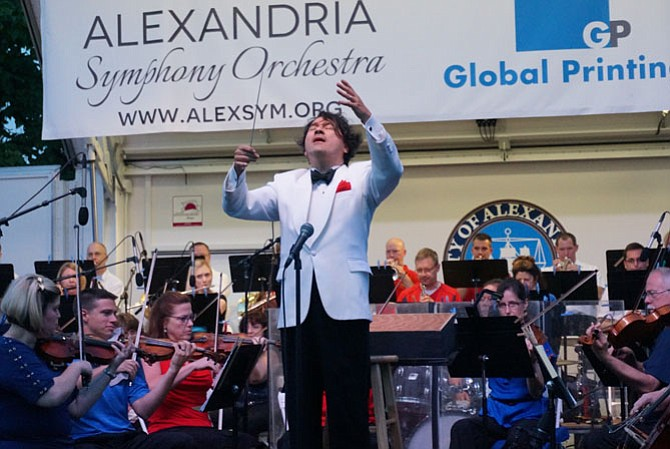 Maestro Kim Allen Kluge, shown leading the Alexandria Symphony Orchestra at the city's 2015 birthday celebration in Oronoco Bay Park, will conduct his final concert with the ASO on May 7 at the Rachel M. Schlesinger Concert Hall.