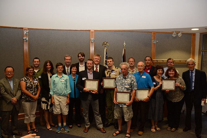 Winners of the 2015 Best Of Braddock Awards stand at the front of the Braddock District government office with local elected officials on July 8.
