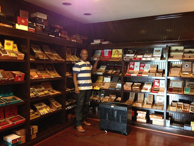 Cigar & More owner Lemma A. Lemma comes from a tobacco background in his native Ethiopia. He opened his first cigar shop in Atlanta in 1999. His walk-in humidor holds hundreds of cigar varieties.