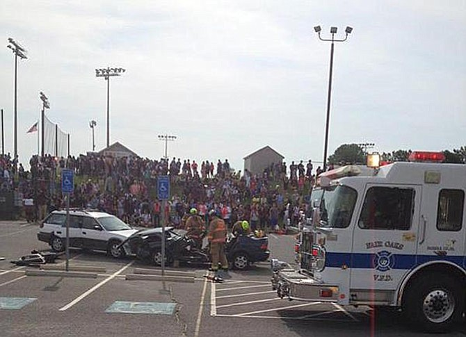 """Firefighters used the Jaws of Life to extricate """"victims"""" after this """"crash"""" at Centreville High."""