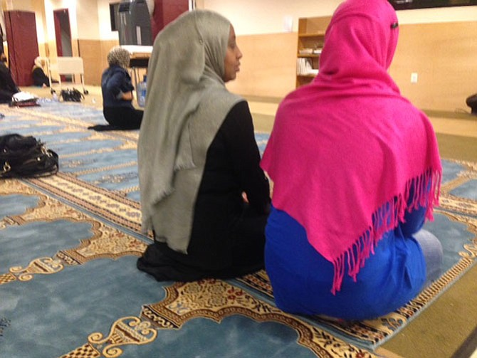 Amal Yousef and daughter Lula in the prayer room at the Muslim American Society Community Center.