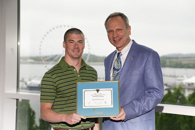 Jimmy McKay, a doctor of physical therapy student at Marymount University, accepts the honorable mention award from Michael Mueller, vice president of the Foundation for Physical Therapy.
