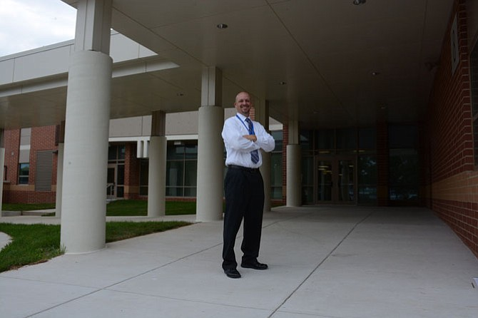Terra Centre principal Greg Brotemarkle shows off the new Kiss-n-ride entrance to the Burke elementary school.