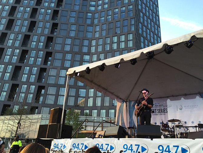 Tony Lucca and ZZ Ward (below) perform at Tysons Plaza last Friday.