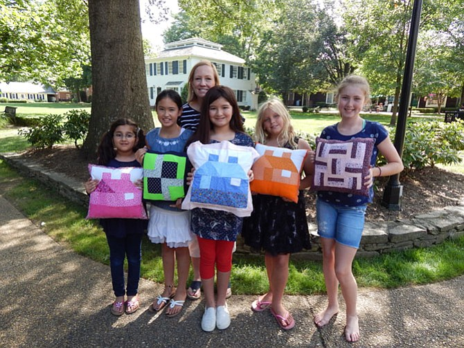 The quilting class with their finished pillows. One side machine quilted and one side hand quilted.