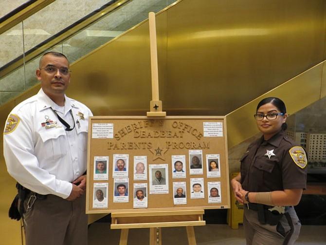 Lt. Richard Laureano and Deputy Daisy Barbadillo with the Deadbeat Parents board.