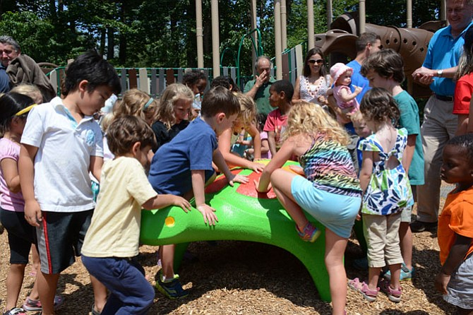 Olde Forge-Surrey Square children help unveil the freshly redecorated turtle, a remnant from the original Surrey Square Park playground.