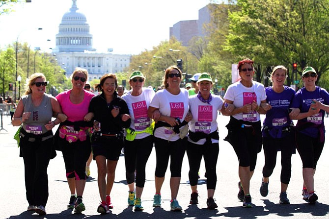 The LOL team in training crosses the finish line at the Nike Women's Half Marathon in Washington, D.C. McLean residents (from left) Chris Fraley, Mary Ellen Overend, Barbara Overstreet, Dorothy McAuliffe (McLean and Richmond. First Lady of Virginia), Lynne O'Brien, Beth O'Shea, Lauren O'Brien (Denver Colo.), Kim Aubuchon and Terry Lineberger.