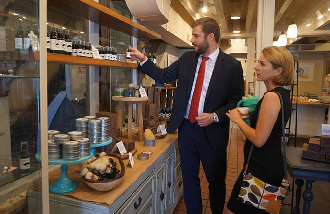 Bill and Alison Rausch browse a selection of handmade bath and body products at Ladyburg, a specialty skin care store now open at 105 S. Union St. in Old Town.