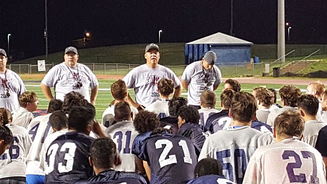 Second-year Woodson head football coach Mike Dougherty is trying to instill toughness in a program that finished 2-8 last season.