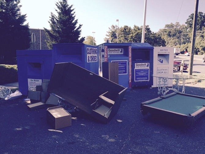 Desks, pool tables and kitchen tables are among the household items Nicole Hudak has seen dumped in front of clothing and book donation bins near the corner of Lee Chapel and Old Keene Mill Roads.