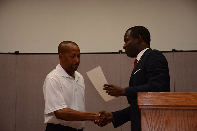 Clifford Brooks III of Prince William County (left) had his rights restored by a decree from Gov. Terry McAuliffe (D), read by Secretary of the Commonwealth Levar Stoney at Bethlehem Baptist Church in Gum Springs.