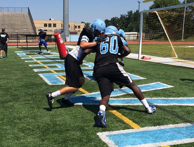 Centreville's Christian Brooks (60) goes against a teammate during a practice drill.