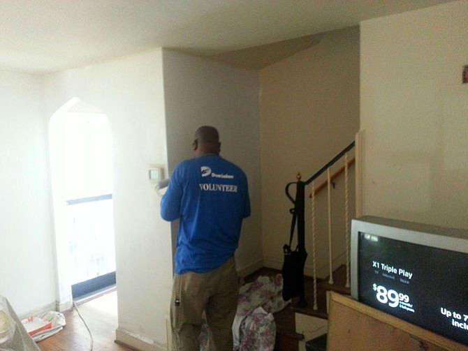 Volunteers from Dominion Virginia Power help repair and maintain a home for Rebuilding Together Alexandria.