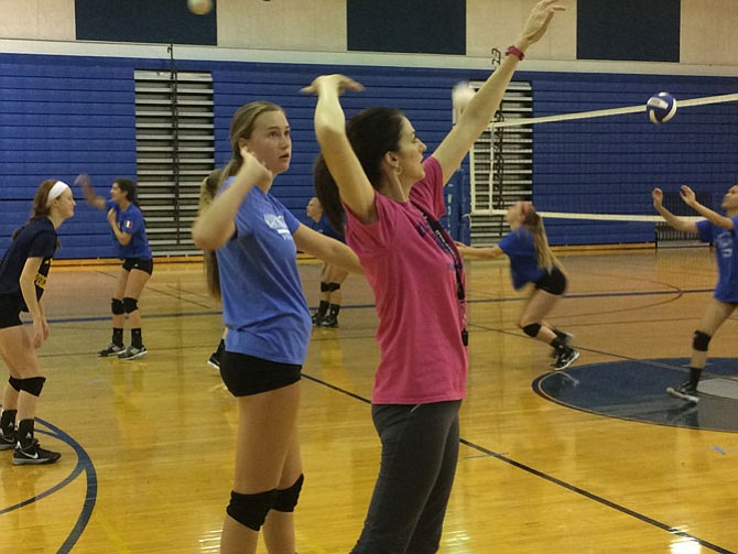 First-year West Potomac volleyball coach Nancy Nixon instructs rising junior middle blocker Laura Aaron during a recent practice.
