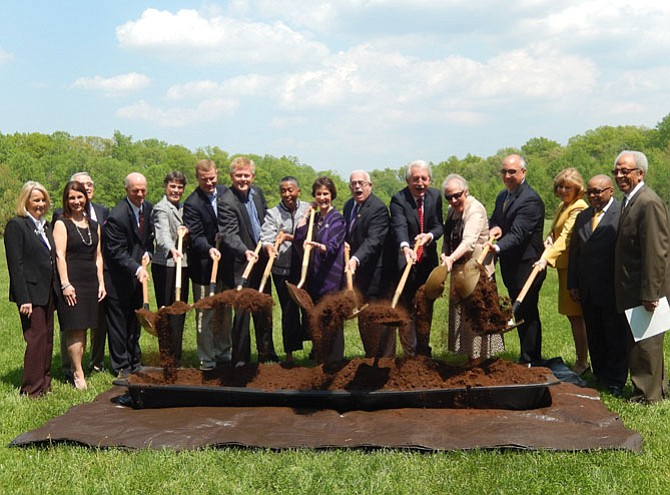 Dignitaries and stakeholders officially break ground for Residences at the Government Center.