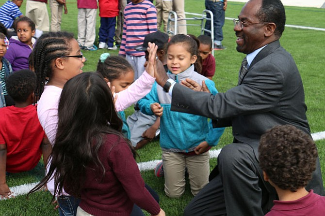 Dr. Alvin L. Crawley, superintendent of schools, talks with students.