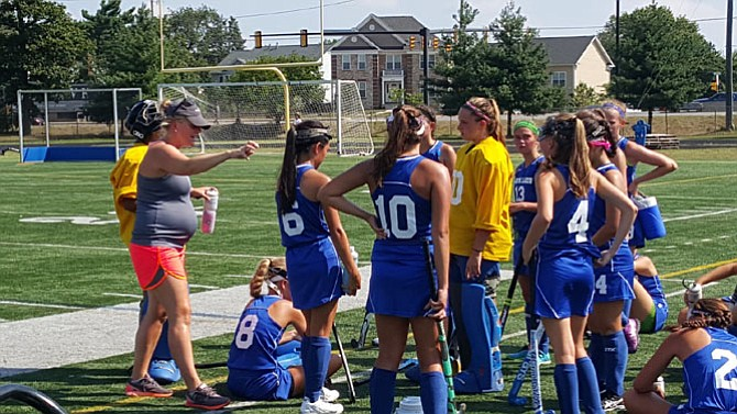 South Lakes head coach Allison Woron, left, talks to the Seahawks during the Under the Lights tournament at Lee High School.