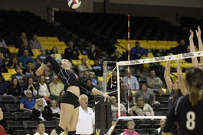 Madison outside hitter Natale Zanellato, seen during the 2014 state tournament, returns for her senior season after helping the Warhawks finish 6A state runner-up.