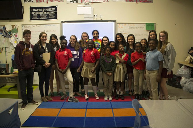 McLean High School students visiting Stanton Elementary in D.C. last year.