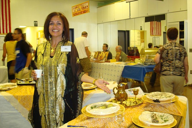 Nikki Haddad points to some of the Middle Eastern dishes for sale at Holy Transfiguration Melkite Greek-Catholic Church's annual Middle Eastern Food Festival running over Labor Day weekend.