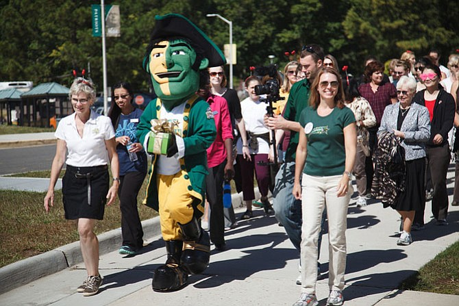 "Staff, students and faculty at George Mason University take part in ""Who's Walking Wednesdays,"" an effort to increase physical activity and well-being. Research shows that workplace health programs can lead to increased productivity."