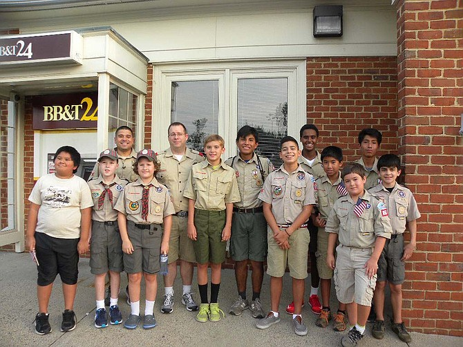 Springfield boy scouts Pack 868 and Troop 856 march in the 14th Annual BridgeWalk in Springfield.