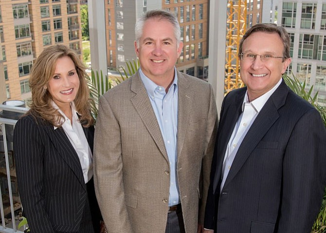 From left: Principal and Executive Vice President Julie Zelaska; Founding Principal Marty Schnider; and Founding Principal, President and Principal Broker Ron Smith formed a new development/real estate/condo/custom home firm in Arlington called Smith | Schnider.