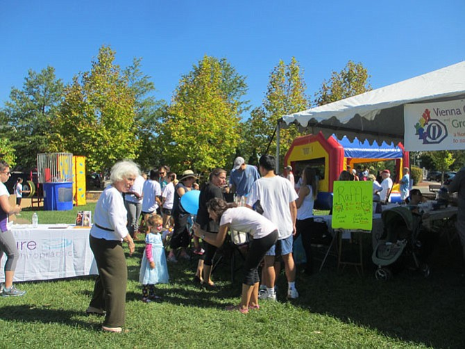 "Family Fun Day for ""Growing Hope"" offers activities for children, and music and free refreshments for all. Fundraising vehicles include raffles and an auction."