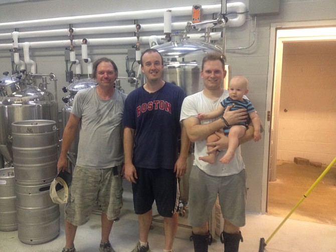 Co-owners of Aslin Beer Richard Thompson, Andrew Kelly, and Kai Leszkowicz at 257 Sunset Park Drive in the Town of Herndon. Aslin Beer, Herndon's first small-batch brewery or nanobrewery, will open Sept. 19.