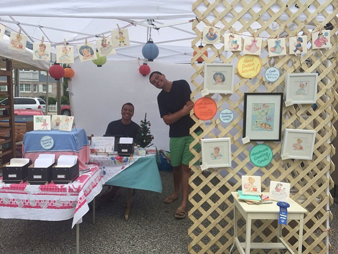 "From left -- brothers Shane and Patrick Hulse sell their ""Little Wishes"" greeting cards at the Cape May, N.J. promenade craft show."