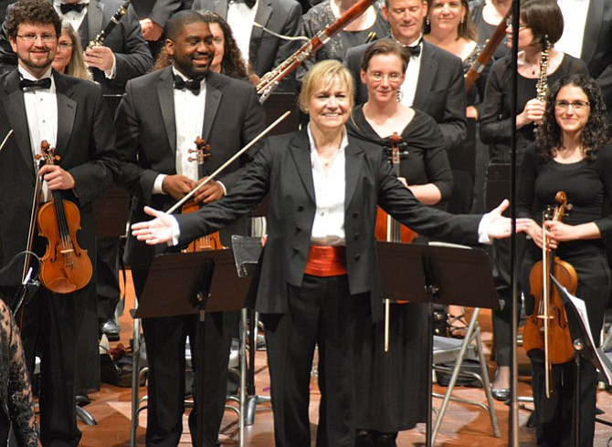 "Miriam Burns is the orchestra's conductor and musical director. ""One of my favorite things is to introduce people to a piece for the first time,"" she said."