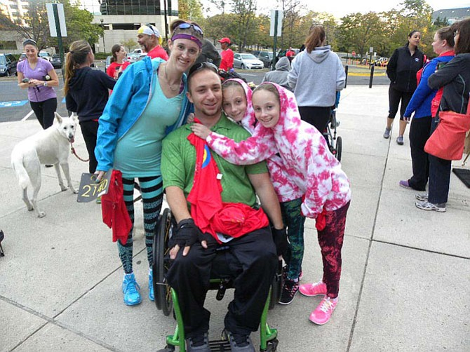 Jesse Graham, of Bristow, Va., with wife Bobbie and twin daughters Makaylee and Madisen, 9. Graham broke his neck in a snowboarding accident 18 months ago.