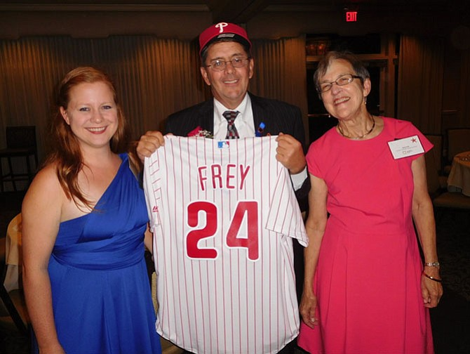 Michael Frey with his Phillies cap and jersey from (from left) labor center Director Molly Maddra-Santiago and CIF President Alice Foltz.